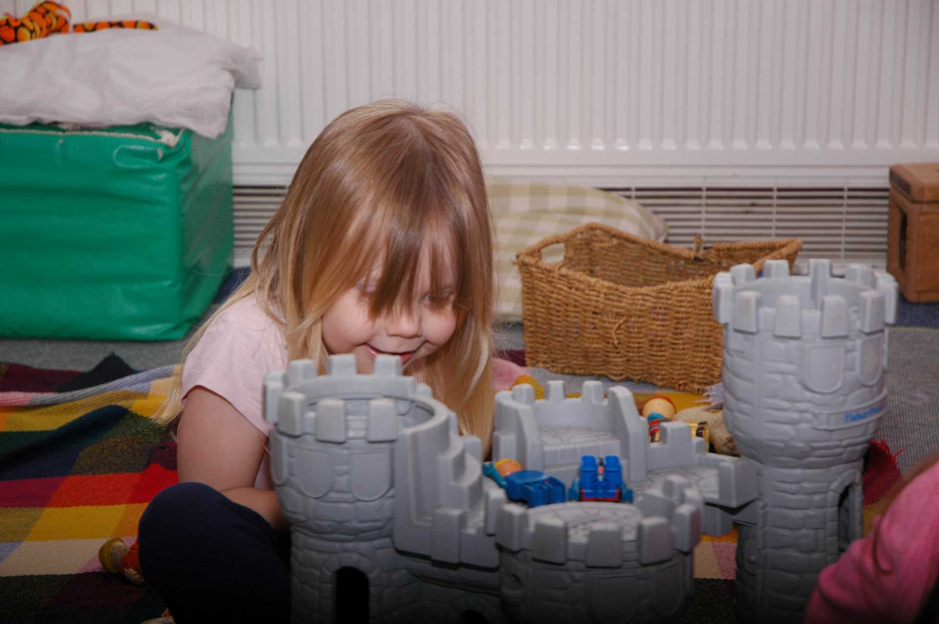 Emily-playing-with-castle