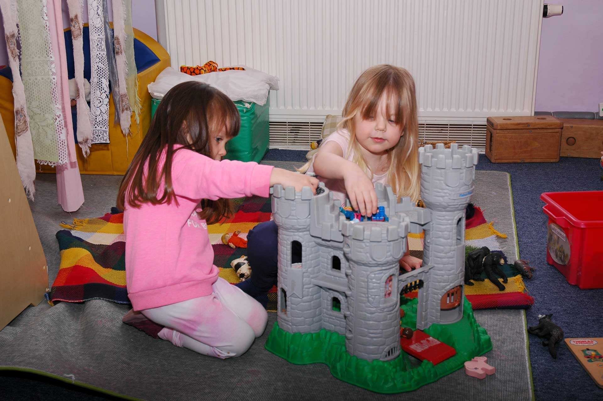 Olivia-and-Emily-playing-with-castle